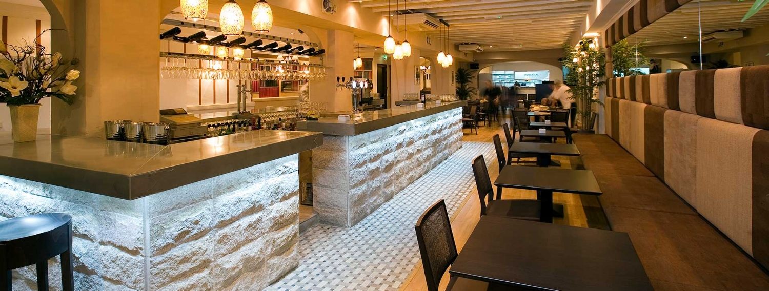 Corks Wine Bar - One of Gibraltar's trendiest meeting and eating places with a glassed-in patio-style frontage and comfy inside seating.