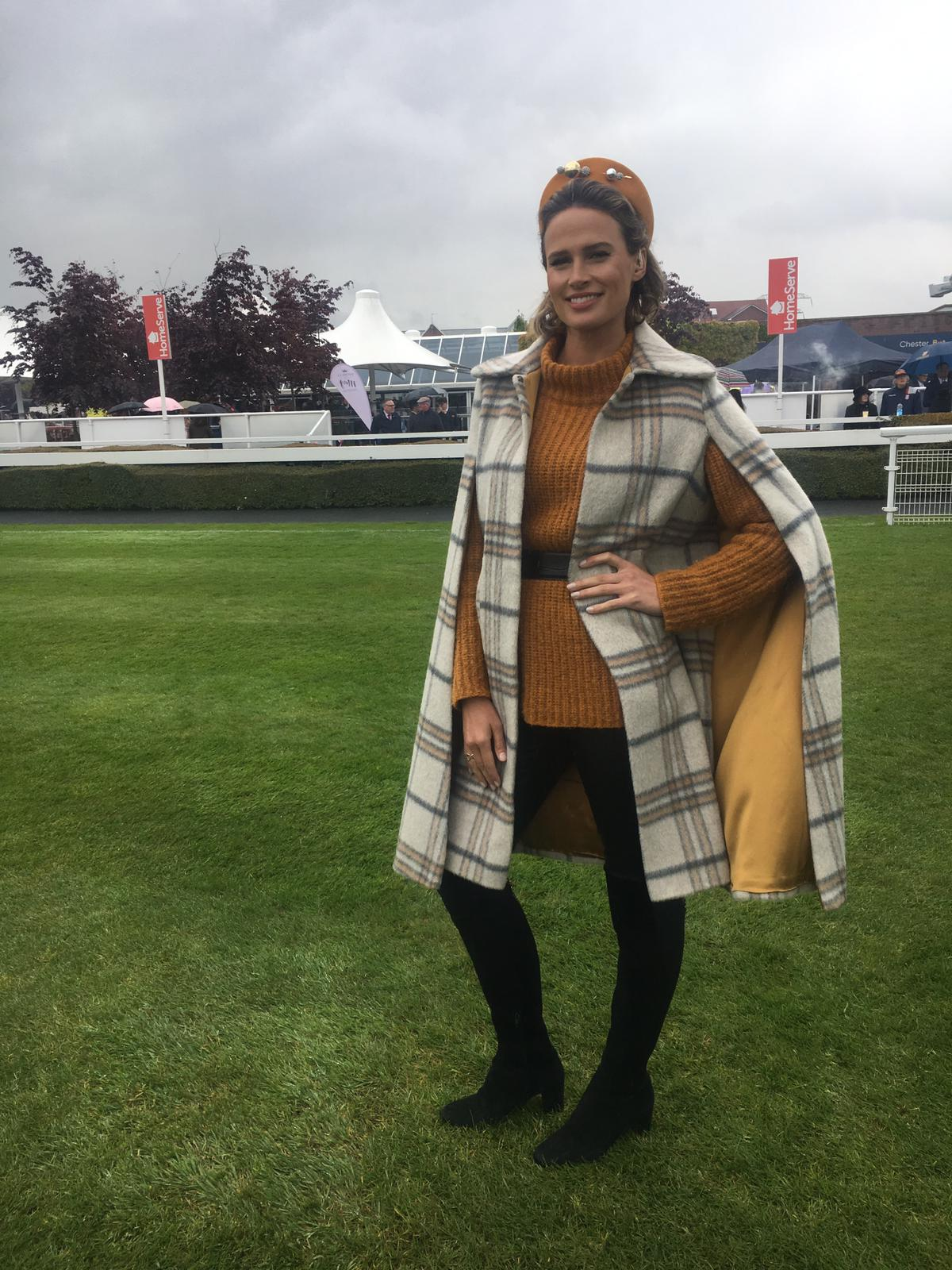 Francesca Cumani in the cape coat on ITV Racing