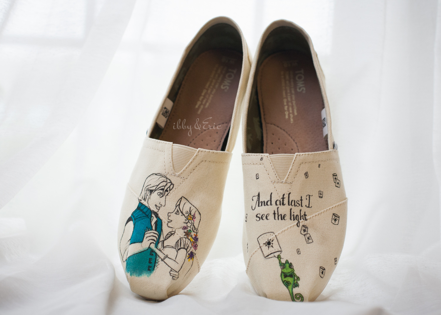 Custom TOMS wedding shoes with characters and a love quote from the movie Tangled.