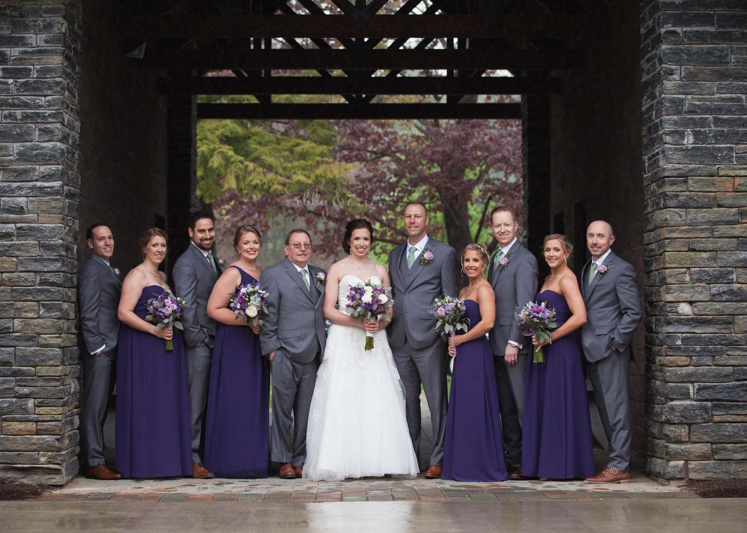 Purple and gray wedding party on a rainy day.