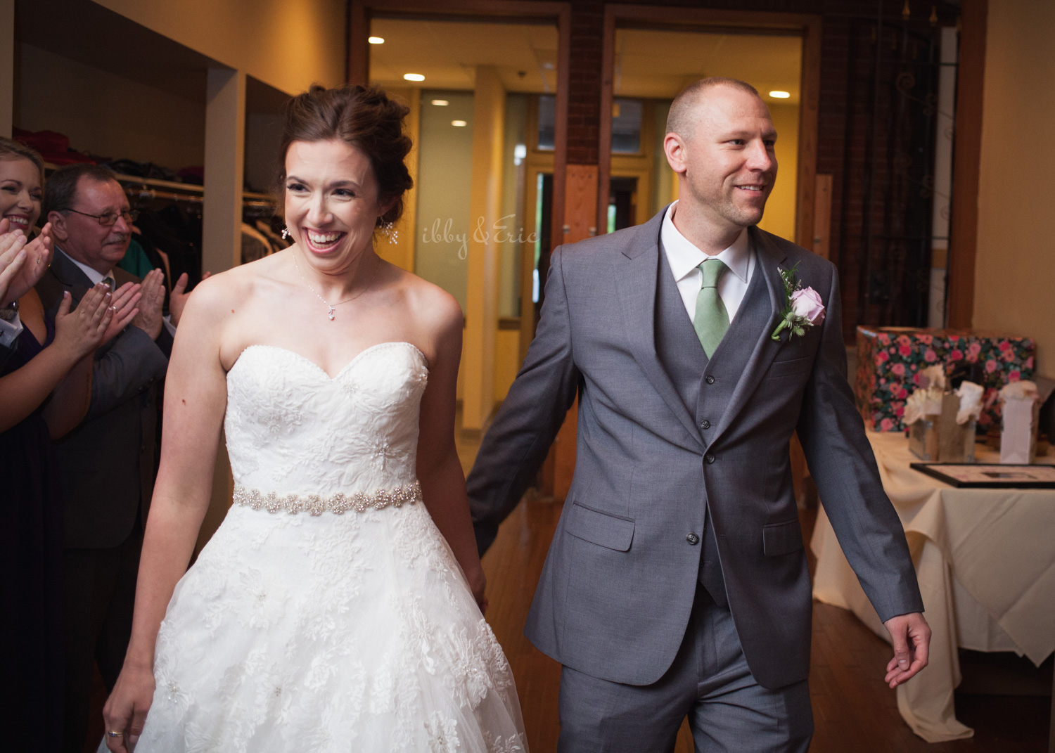 Happy couple getting introduced into their reception for the first time as husband and wife.