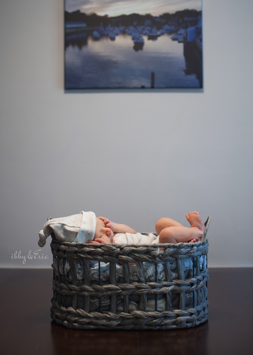 Massachusetts in home newborn photo of a one week old baby boy in a gray basket.