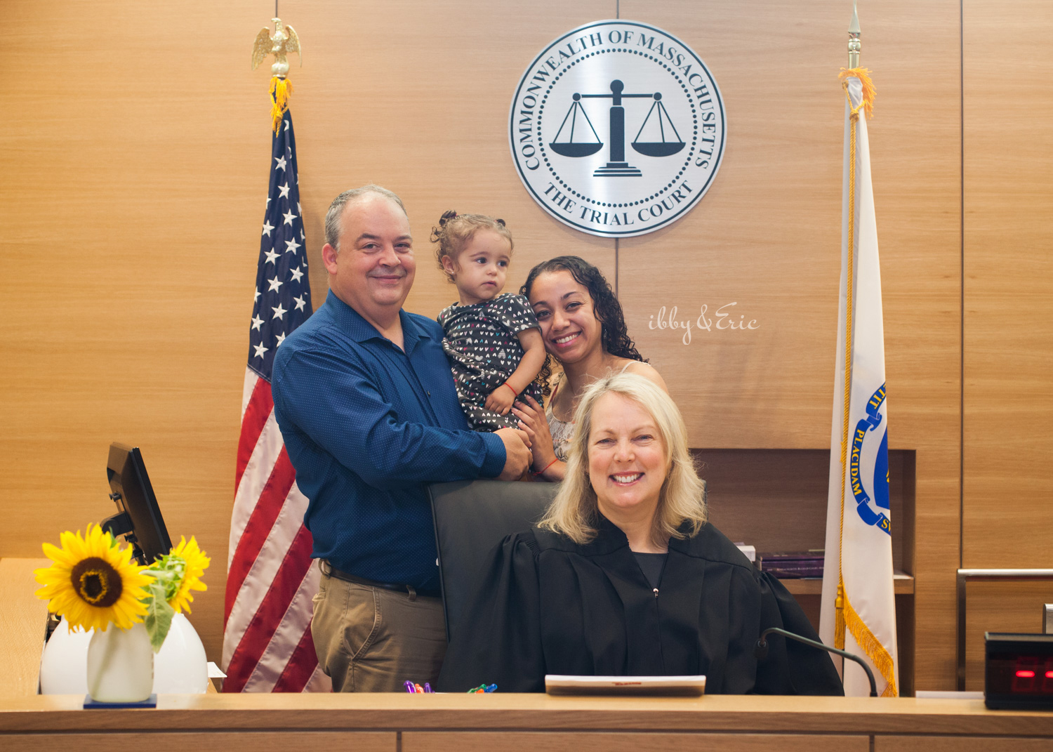 A Franklin County Superior Court judge poses for a photo with a happy family that just completed their adoption ceremony.