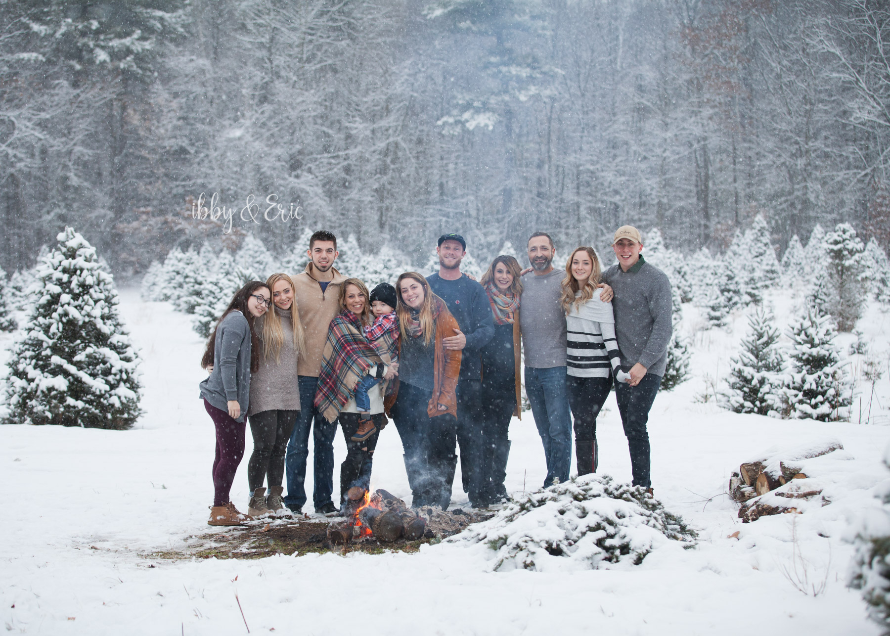 Family of 11 gathers around a fire during a snowstorm in western Massachusetts.