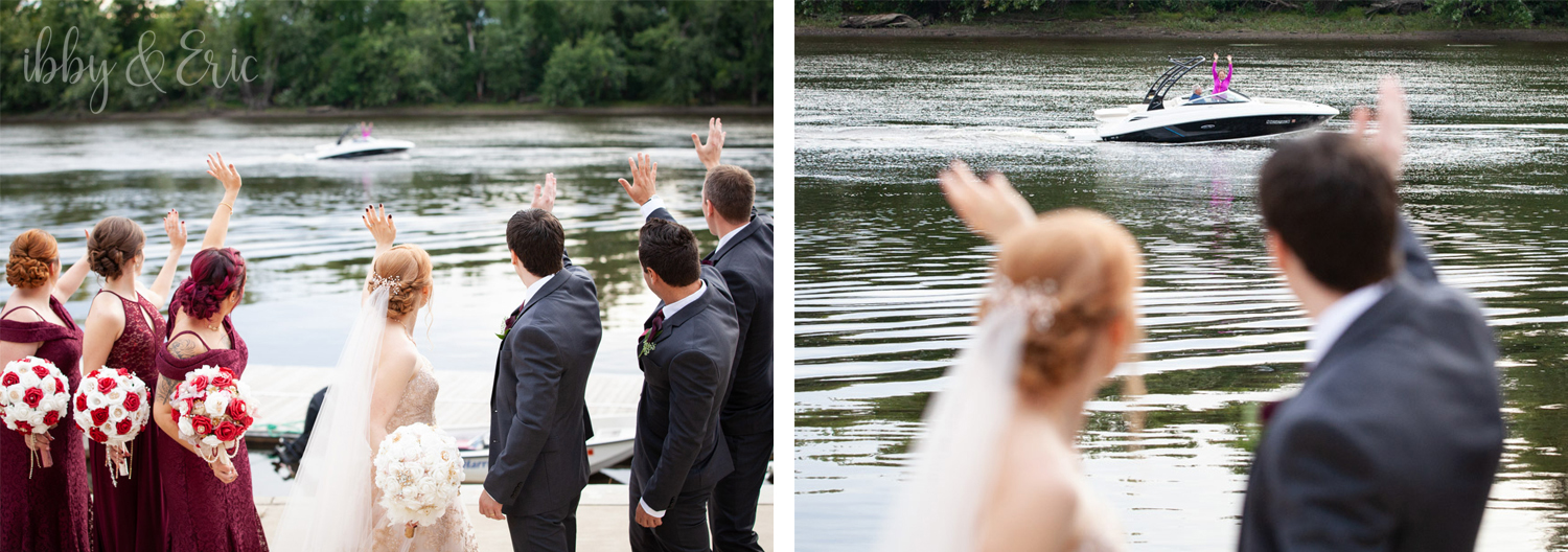 The wedding party turns back to wave to a woman in pink driving by in a boat.