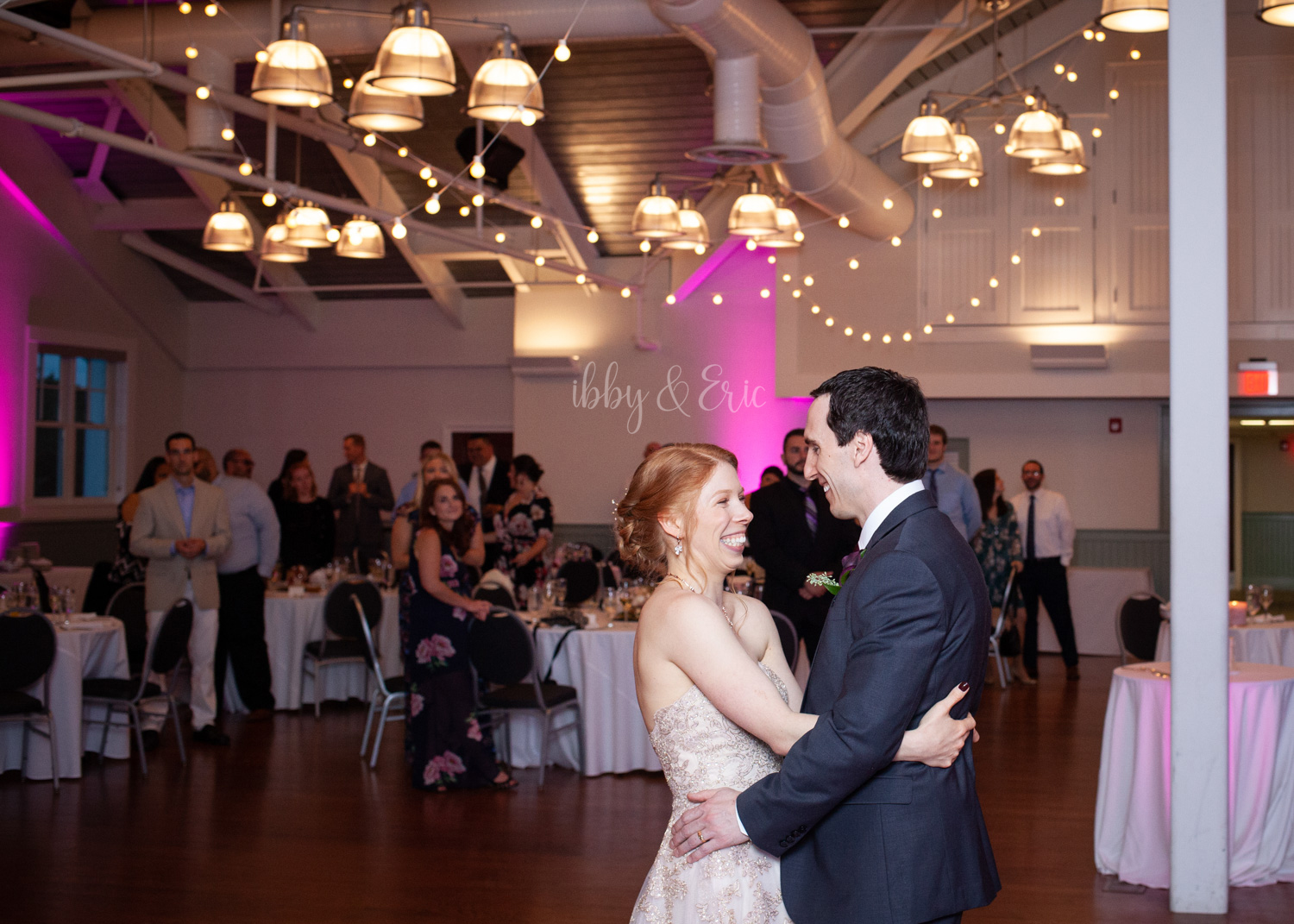 Bride & groom look at each other while hugging during their first dance.