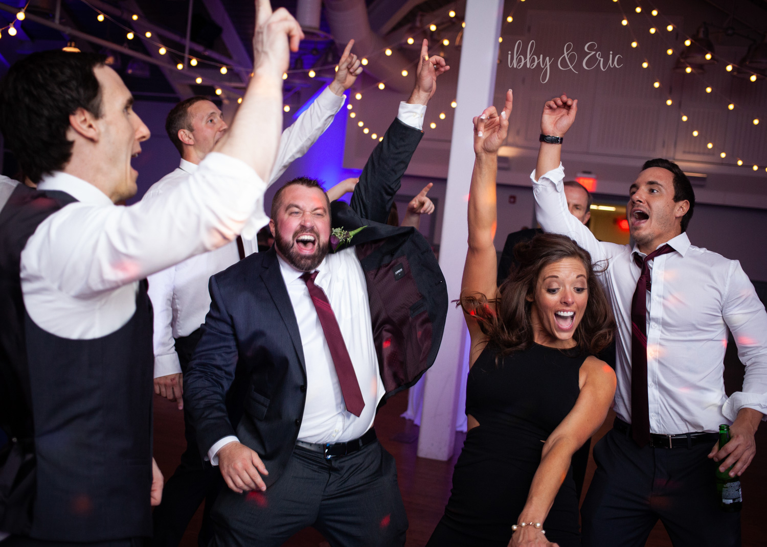 Groom and friends dance during the Glastonbury Boathouse wedding reception.