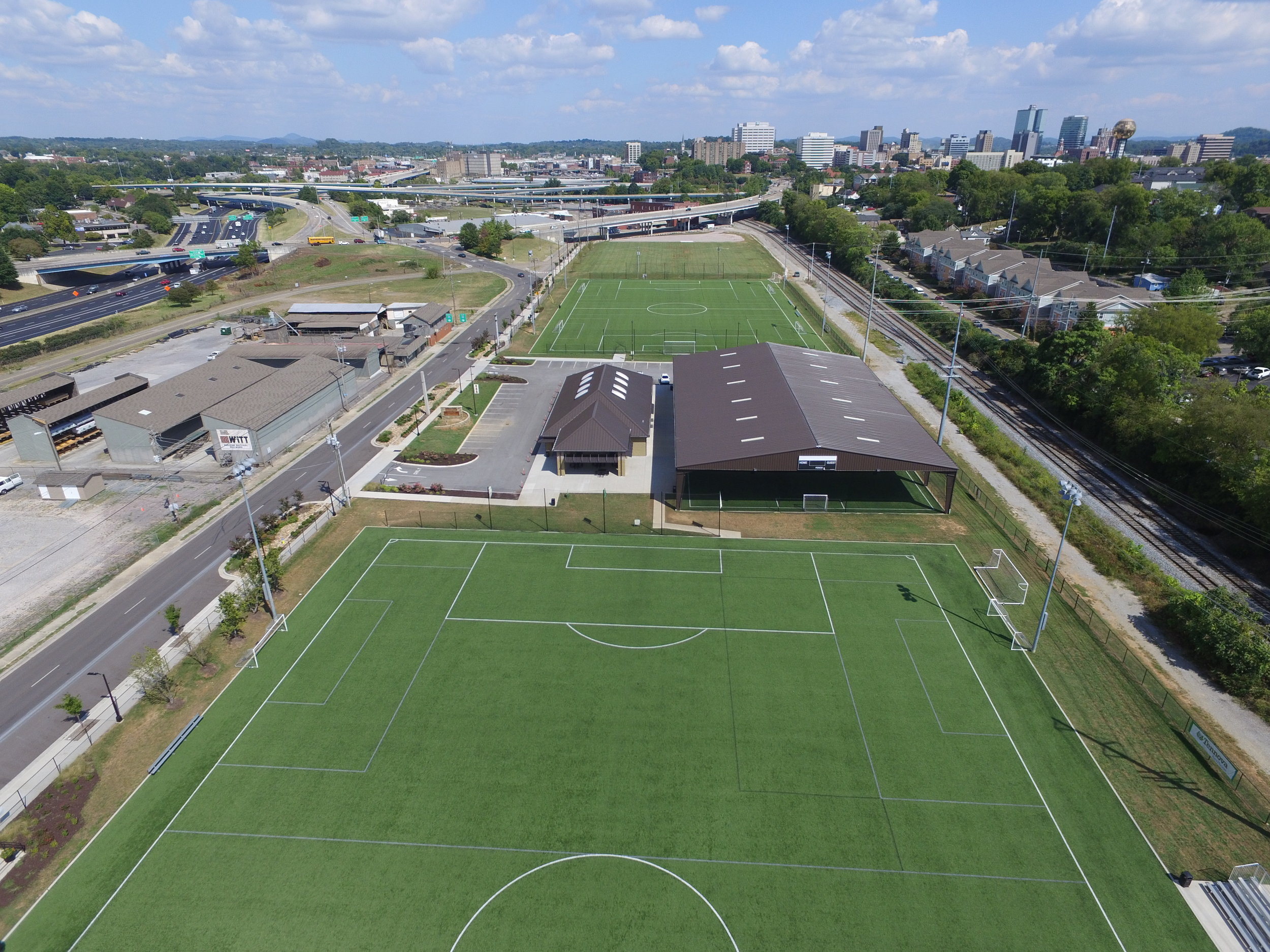 Distinguished Multi Field Facility Award in 2016for the Sansom Sports Complex in Knoxville, TN.Construction of two full size synthetic soccer fields, one natural grass field, fencing and netting, a pavilion covered field with adjacent fieldhouse and parking lot. Work also included a redesigned city streetscape with curbing, sidewalks, bus stop and landscaping. -