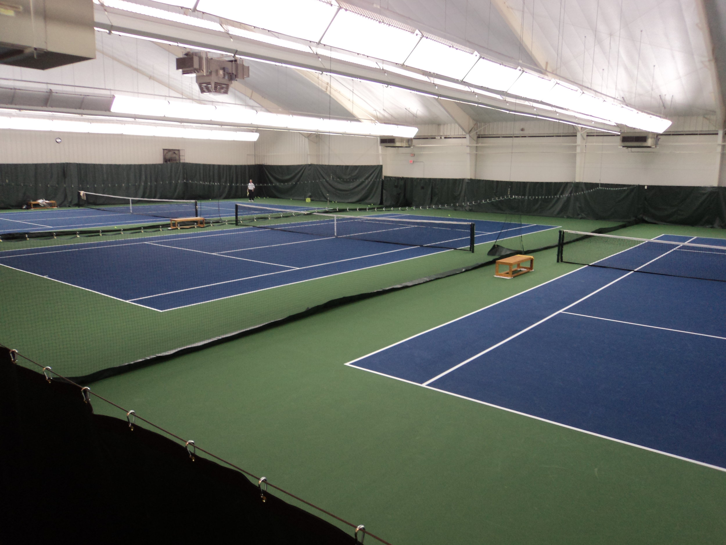 Baseline Sports Construction received an Indoor Tennis Facility of the Year Award in 2011for work on the indoor tennis facility at Belle Meade Country Club in Nashville, TN. The project consisted of digging out 8 existing flood damaged tennis courts with an asphalt base and replacing them with a post tension concrete base and cushioned acrylic surface. The project also included new backdrop and divider curtains, column pads, and net posts. -