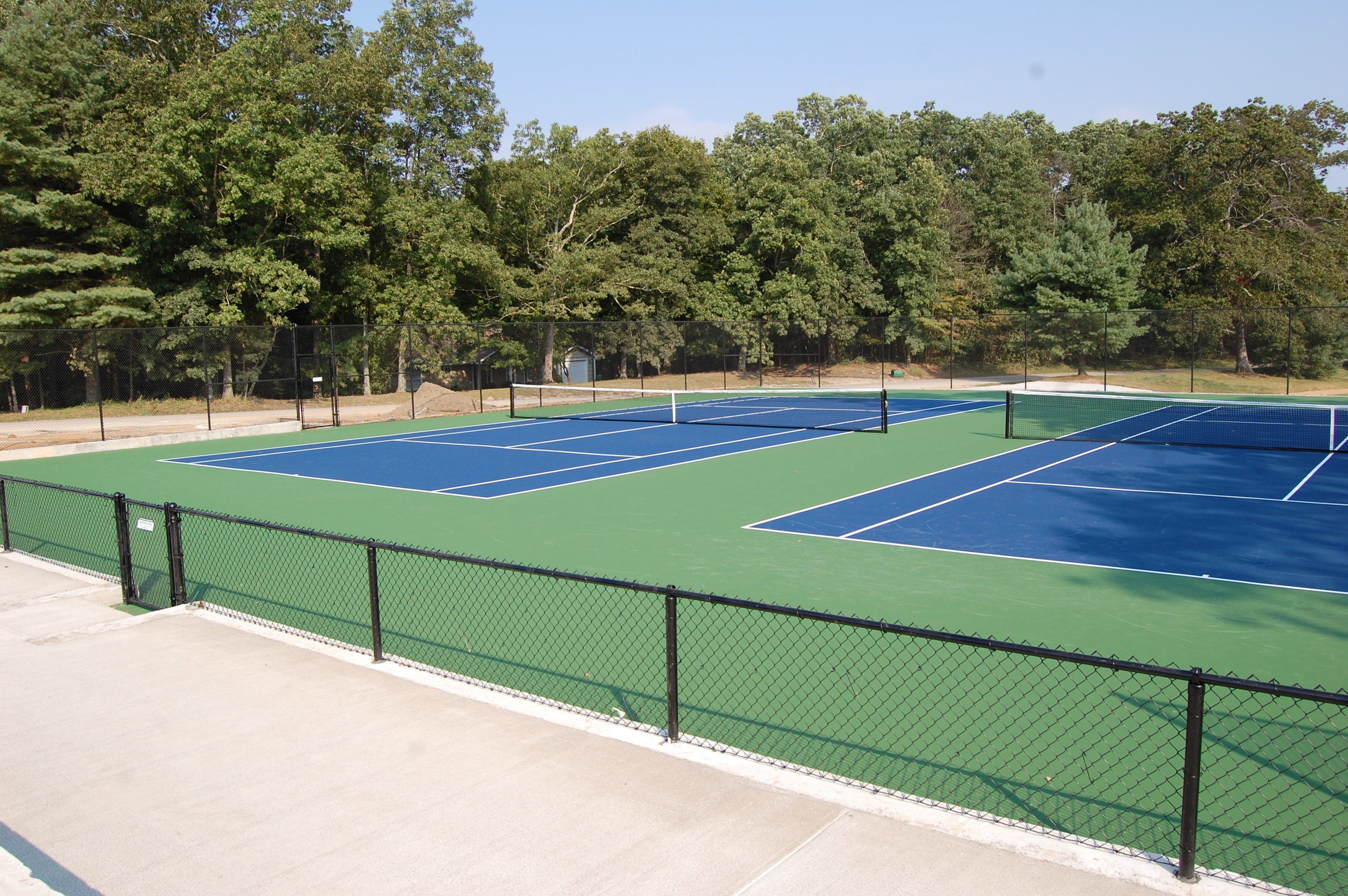 The University of the South received a Distinguished Outdoor Tennis Facility Award in 2013for new construction of two varsity tennis courts. The project consisted of site work, retaining walls, base construction, fencing and surfacing to add two courts to their existing varsity tennis facility in Sewanee, TN. -