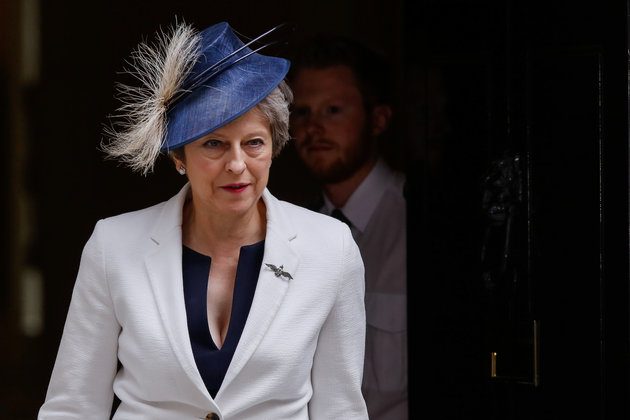 Theresa May, U.K. prime minister, departs following a cabinet meeting at number 10 Downing Street in London, U.K., on Tuesday, July 10, 2018. Maylooked likely to survive any attempt to oust her over the government's Brexit strategy for now, and is leaning on the biggest opposition party to help get the plan through parliament and counter a mutiny by a group of her own lawmakers. Photographer: Luke MacGregor/Bloomberg via Getty Images