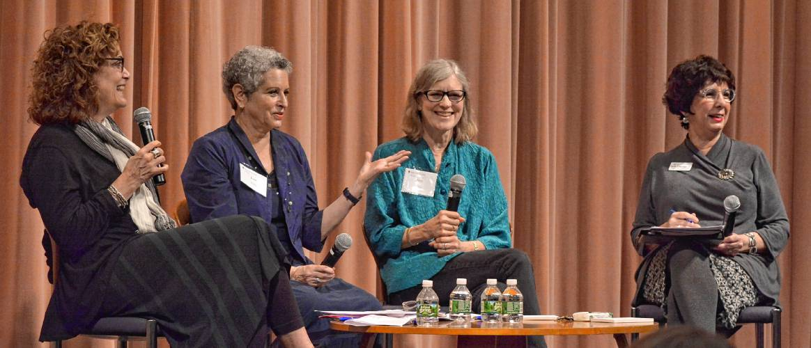 Liz Szabla, from left, Jean Feiwel and Ann M. Martin talk during a panel discussion on publishing stories for young readers moderated by Susan Etheredge, right, Thursday, Oct. 11, 2018 in Weinstein Auditorium at Smith College. Szabla and Feiwel are publishers; Martin is an author. Etheredge is the dean of the college and vice president for campus life.