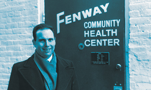 Photo Courtesy of  Fenway Health    Board of Directors Chairperson Stewart Landers stands in front of Fenway's original entrance on Haviland Street.