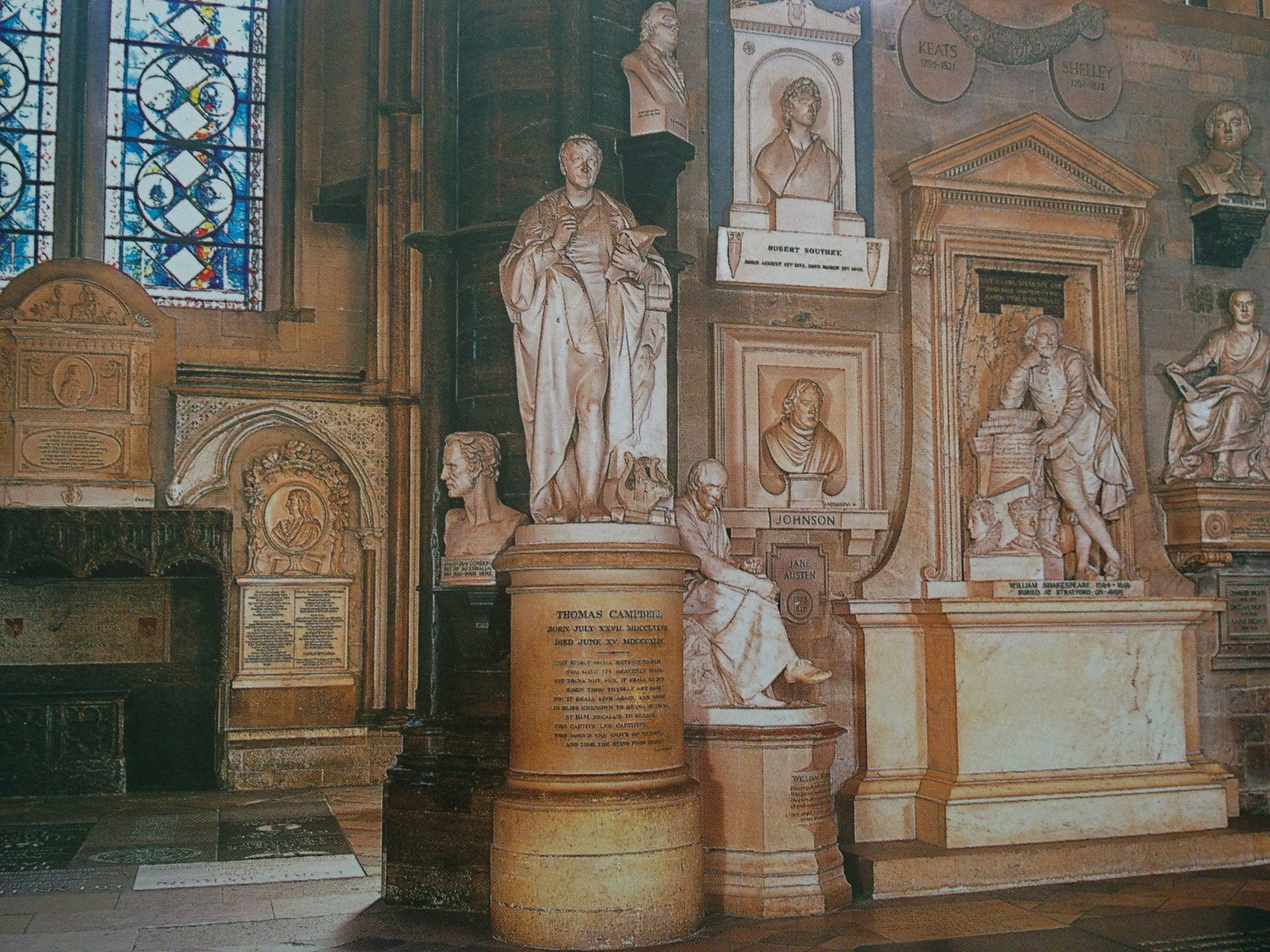 Photo Courtesy of  Westminster Abbey . /The Poet's Corner of Westminster Abbey. Jane's plaque is pictured, slightly hidden behind the statue of the seated man.