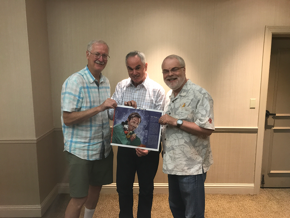 """John Musker, Ron Clements & myself holding my cover to """"Walt's Imagination"""" book"""
