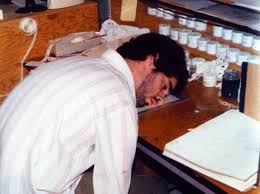 """Pic of John sleeping at his animation desk in Don Bluth's garage during the production of """"Banjo The Woodpile Cat"""" - circa 1978-79"""