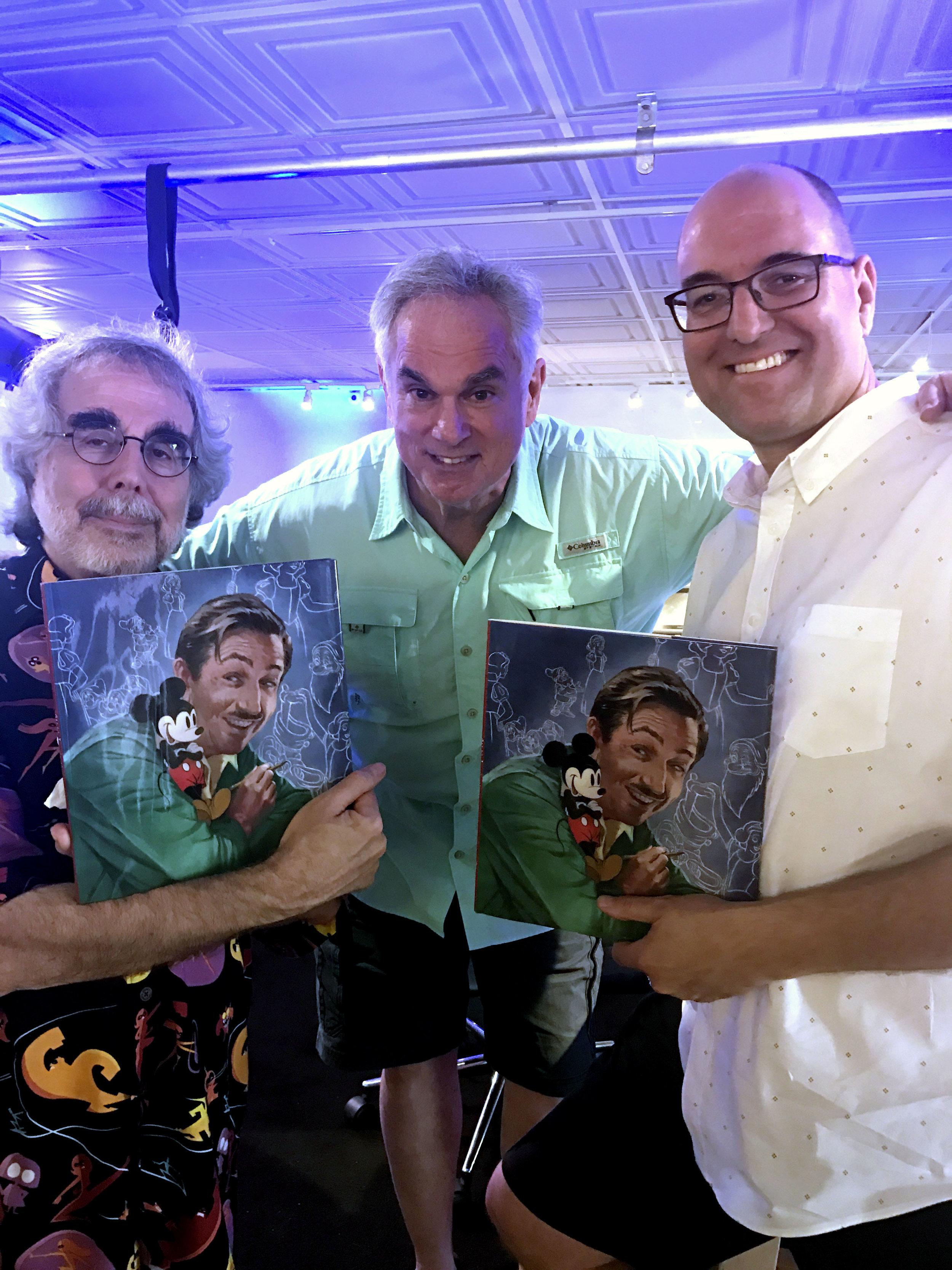 John with friends, Charles Solomon and Tony Bancroft.