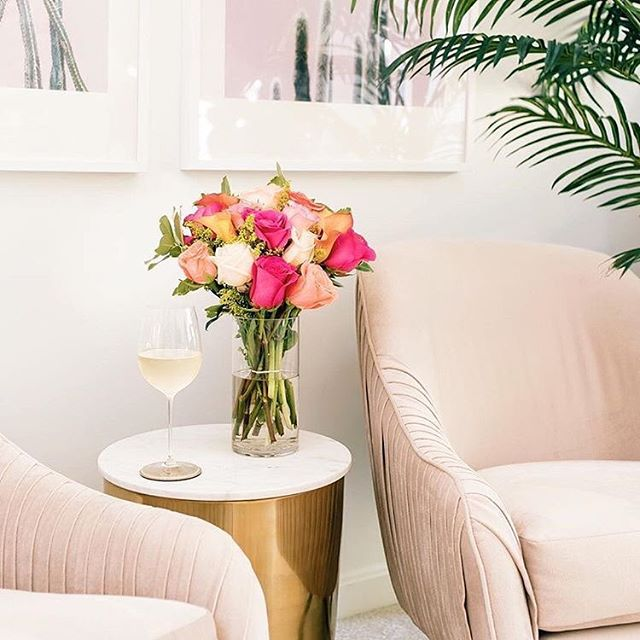 Now this little lounge area in @laurametzlerphoto bedroom is speaking my language! Pink flowers✔️, gold accent table✔️, wine✔️, and my favorite West Elm chairs by Roar + Rabbit 😍 Mark my words, I WILL find a spot for that chair in my home! It's soooo comfy and so gorge...AND it swivels! Okay Instagram fam, what item are you lusting over for your home? . 📸: @laurametzlerphoto