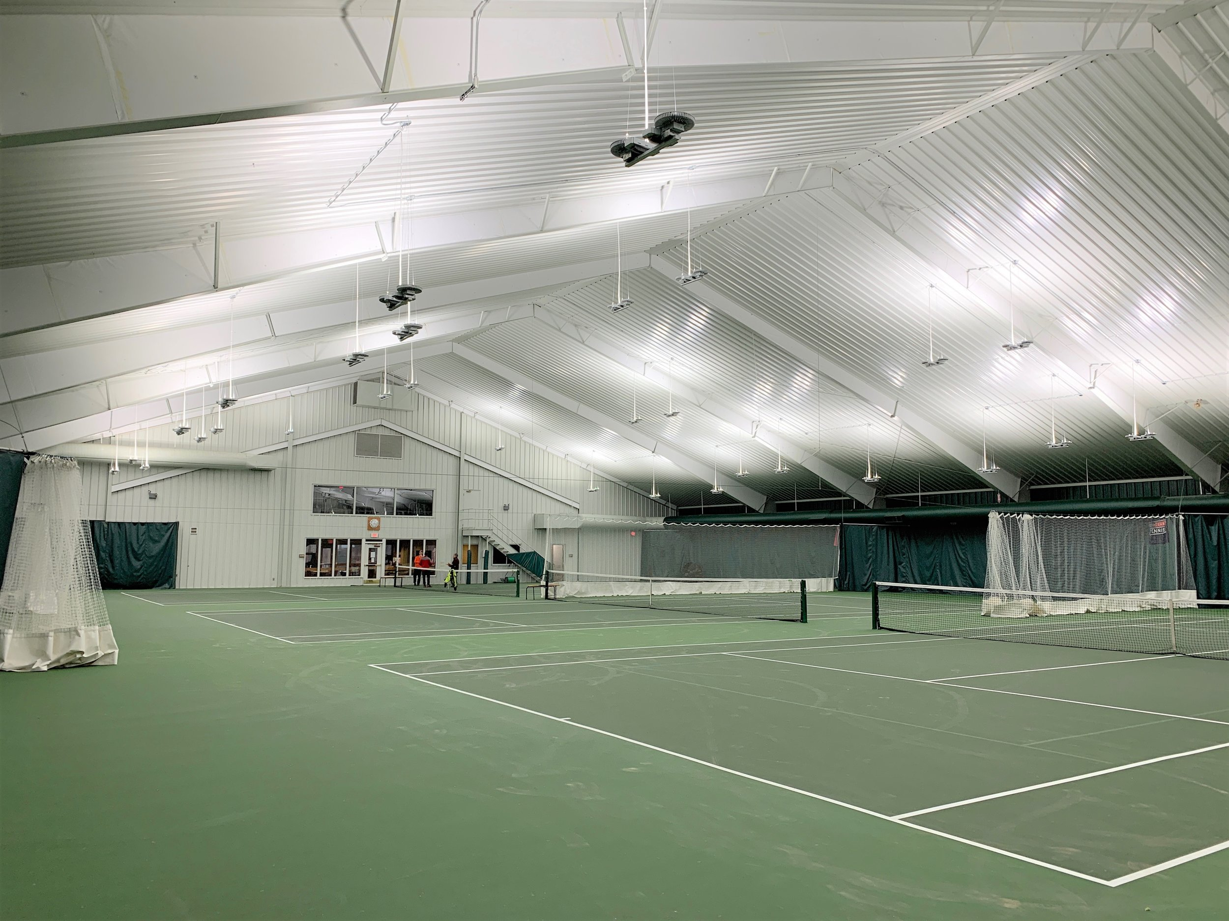 Last week, we finished installation of our indirect LED lighting over the 3 indoor tennis courts at the Arrowhead Country Club, Rapid City, SD. It was a pleasure to work with the staff at Arrowhead and we were able to complete the project within the planned time period and turn the courts back over to the members before the end of the week. We are proud to have partnered with this fantastic club to dramatically increase their light levels. This is the first project we have done in South Dakota and we hope there will be many more in this great state. We would love to help you with your facility needs. To speak with one of our experts and learn about our systems, call us at 847-892-6956 or visit our web page by clicking  here . To see the financial benefits, visit our case studies page  here .