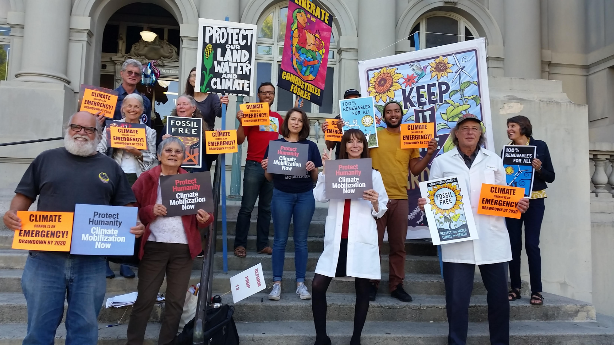 Climate Mobilization, 350, Physicians for Social Responsibility demonstrate their support for the emergency declaration before the Council Meeting.