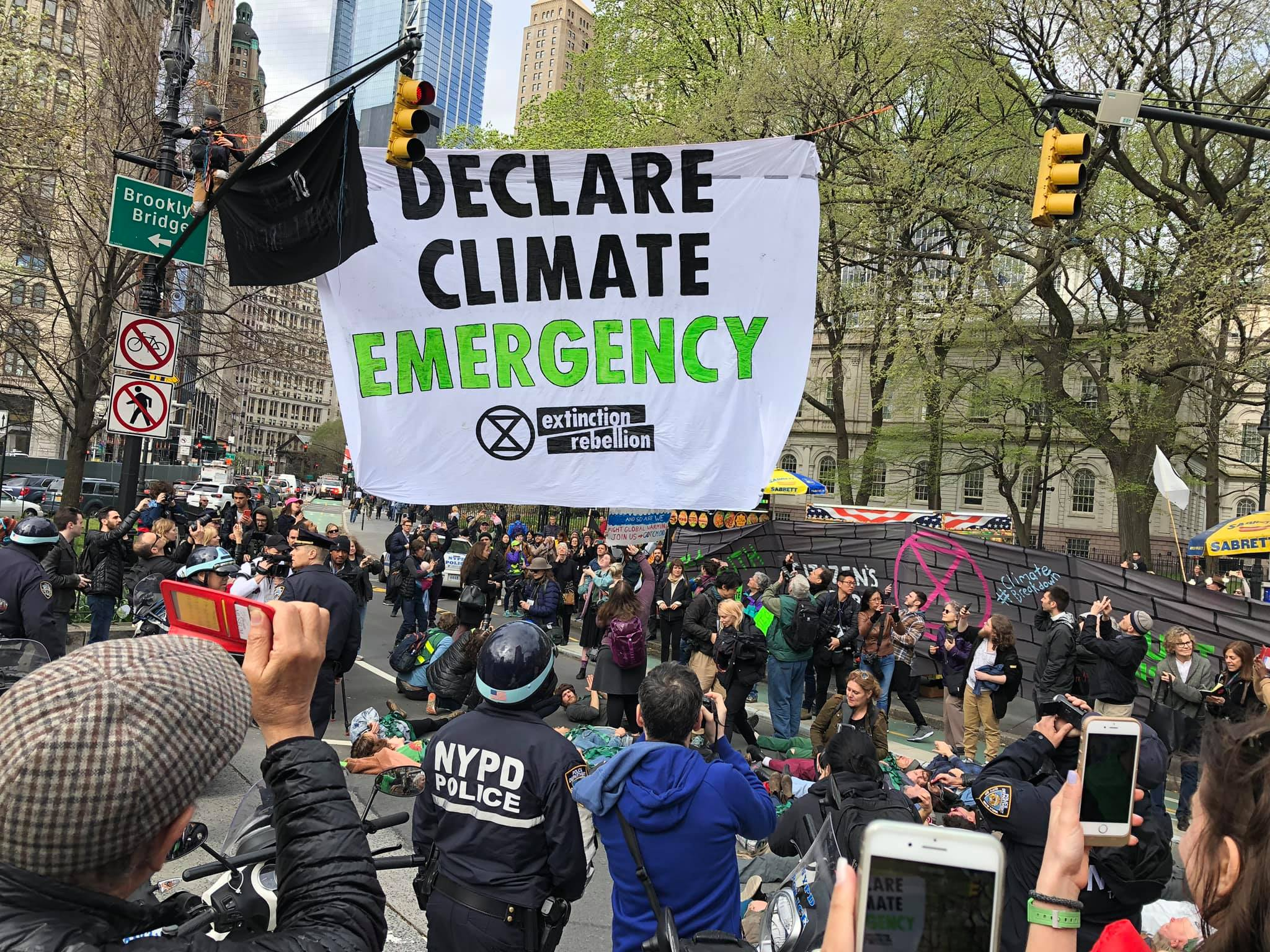 Extinction Rebellion NYC takes to the streets of New York to demand a Climate Emergency be declared in one of the most vulnerable cities in the U.S. to climate disaster. (Image: XR NYC on Facebook)