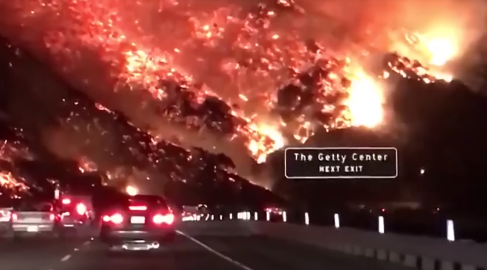 The Skirball Fire engulfs parts of Bel Air next to the 405 Highway on December 7, 2017