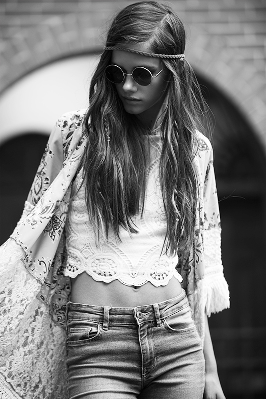 Professional model dressed as a hippie. Black and white editorial photography.
