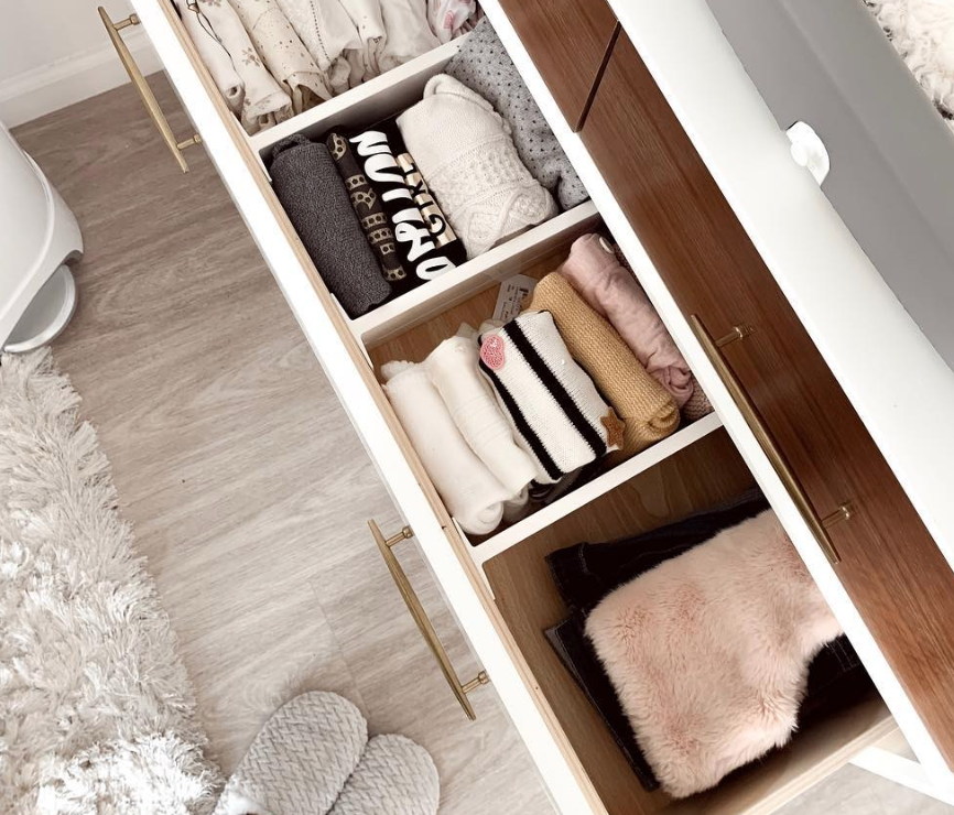 Baby Clothes in a Dresser