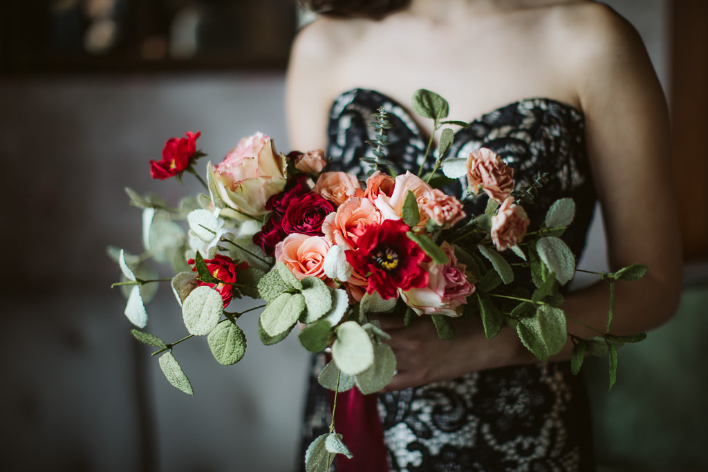 Beautiful bridal bouquet in reds, peaches and pinks