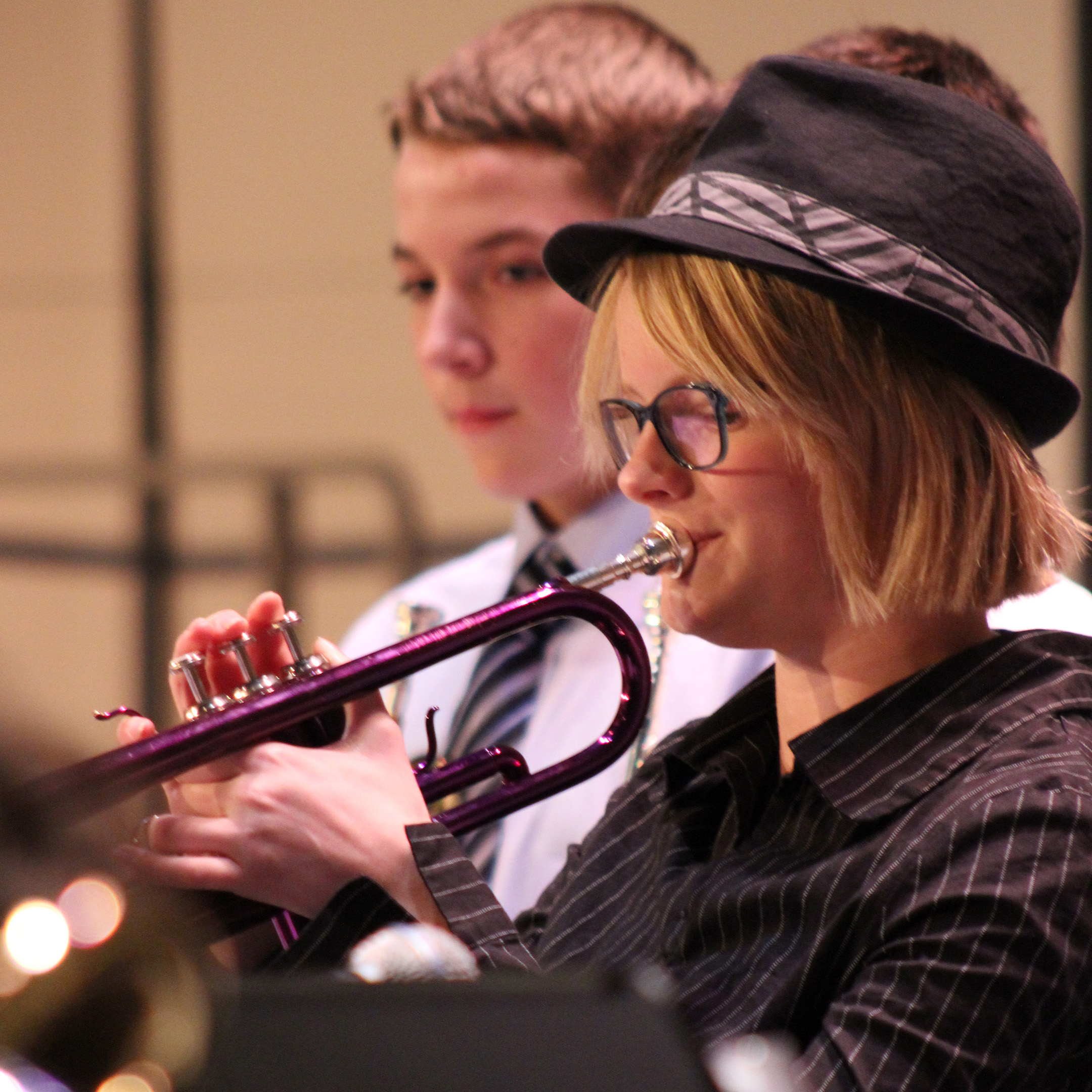 Female trumpet student at a district jazz rehearsal; click through to Jazz Division Page