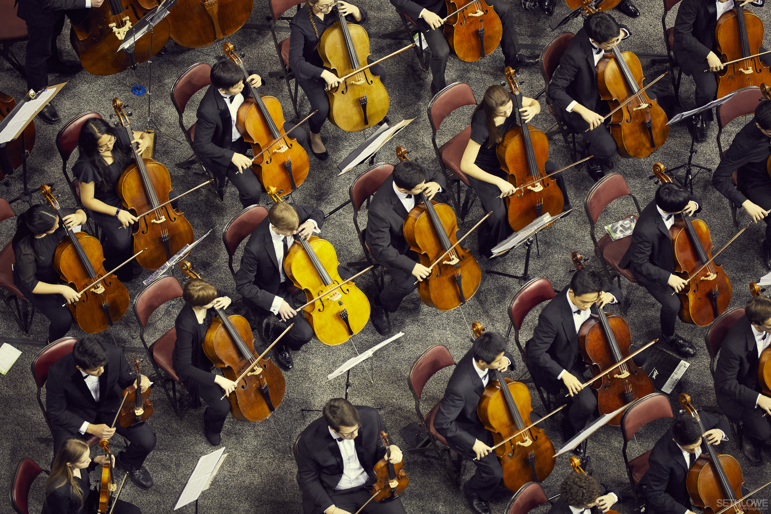 Overhead photo of cellists performing at the All-State Concert with the orchestra; click through to Senior Level Required Music