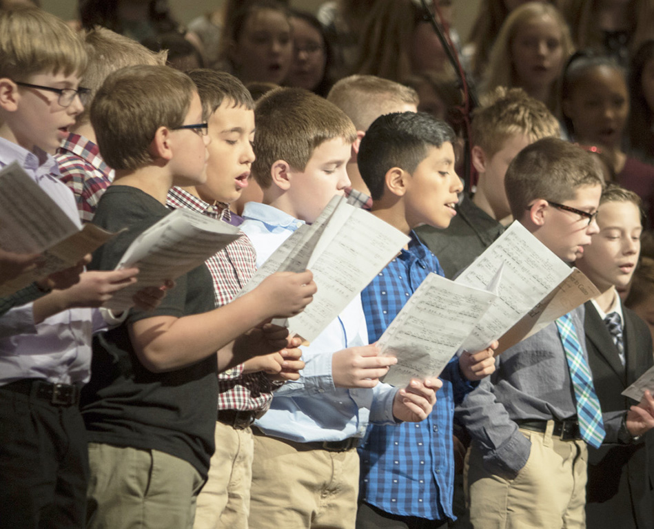 Group of elementary boys singing in an All-State chorus concert