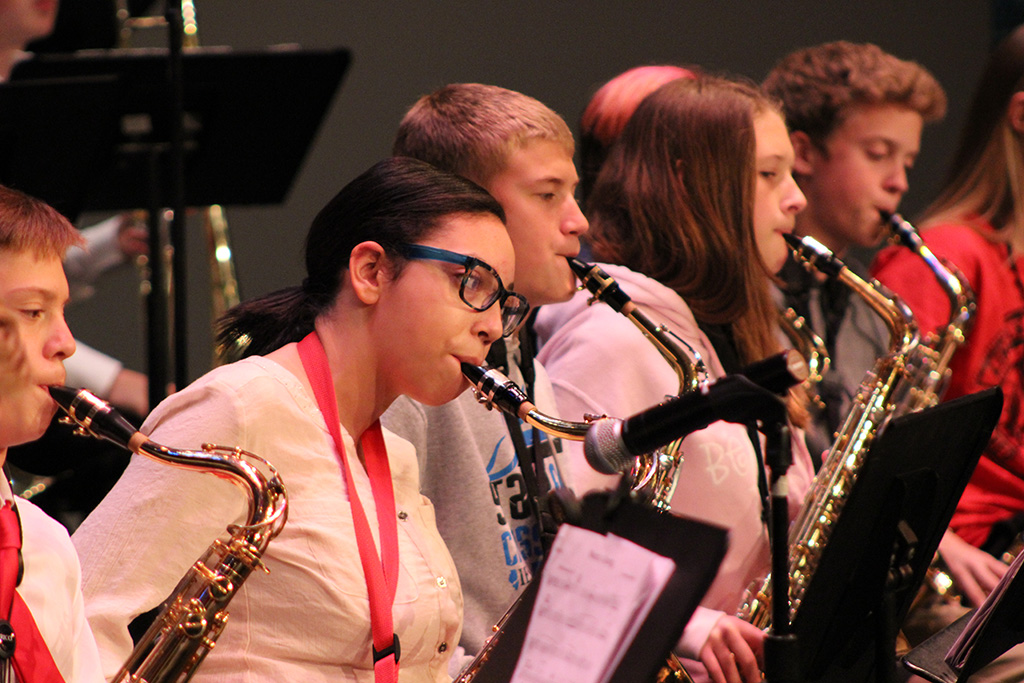 Junior high saxophone student in rehearsal at a jazz festival