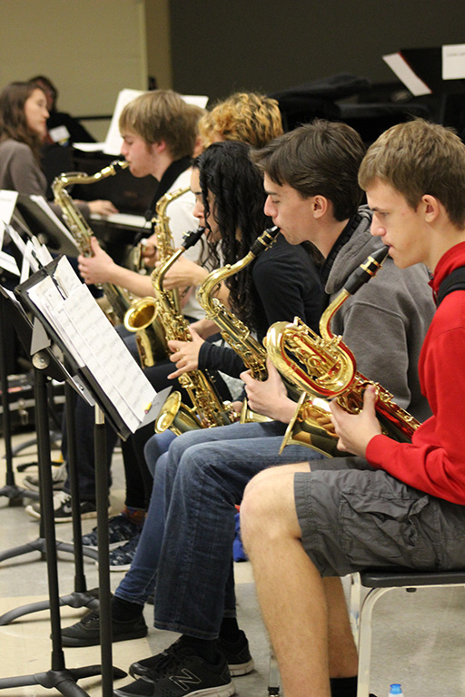 Senior high school saxophone students in rehearsal at a district jazz festival.
