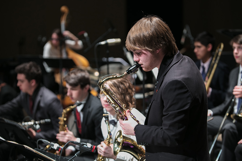 Student saxophone musicians in rehearsal at a district festival