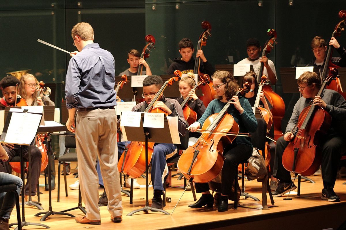 Orchestra students in rehearsal at a district festival