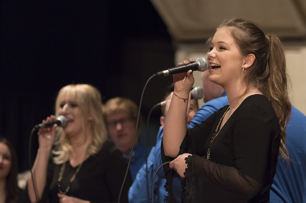 Female vocal jazz singer in performance at the Illinois Music Education Conference