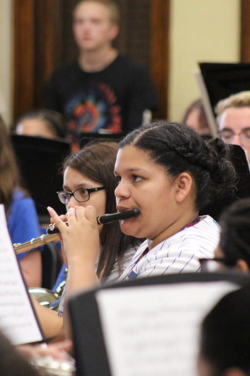 Female student rehearsing on the piccolo