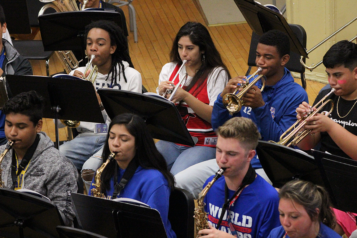 Students at Joliet Central High School rehearse on saxophones and trumpets.