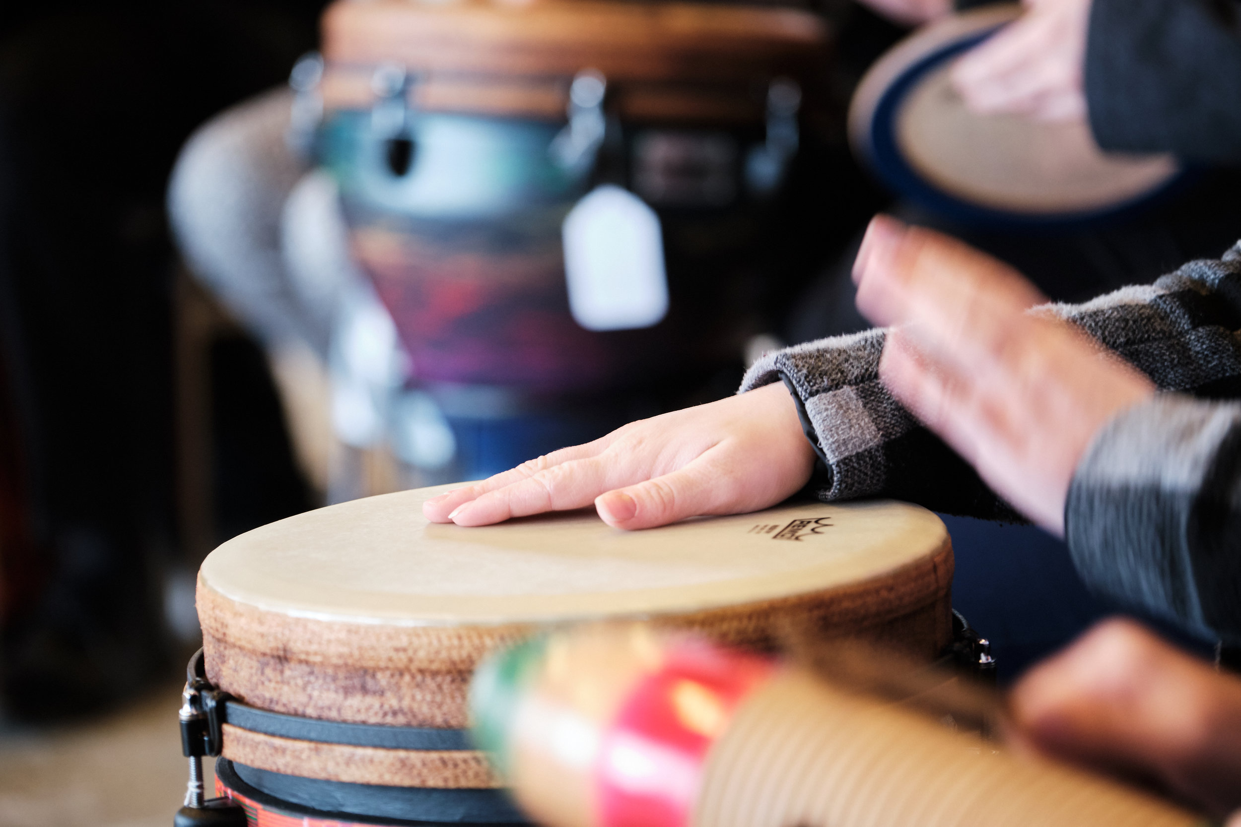 Hands drumming on world drums