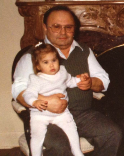 Cristina as a toddler with her Dad, Carmen.