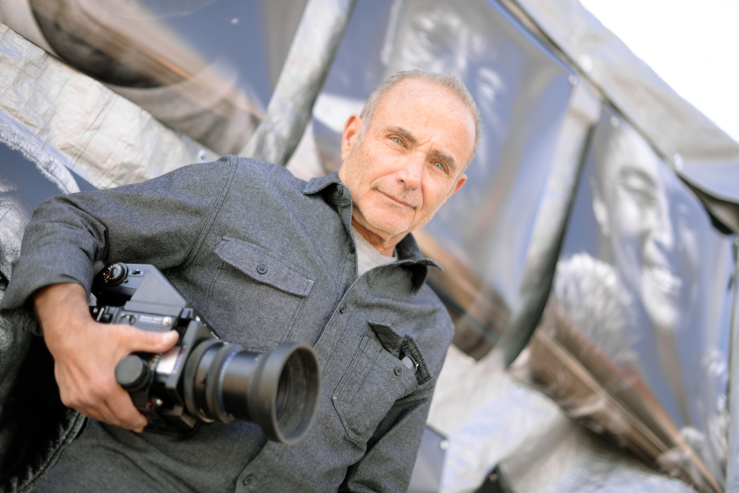 Orie Rutchik outside his mobile portrait studio near the Berkeley Drop-In Center on Adeline Street at Harmon. Photo: Chris Polydoroff    Click here to watch video   by Chris Polydoroff about the Berkeley Portrait Project.
