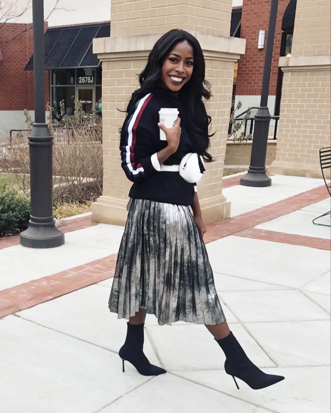 sock booties - Basically a heel that feels like a sock, stays up around my skinny ankle and goes with everything. They look great with skirts and dresses when you want to show a little leg but not distract too much. Now that its cold AF outside I love wearing these in the place of pumps, you get the same look but your feet stay warm!