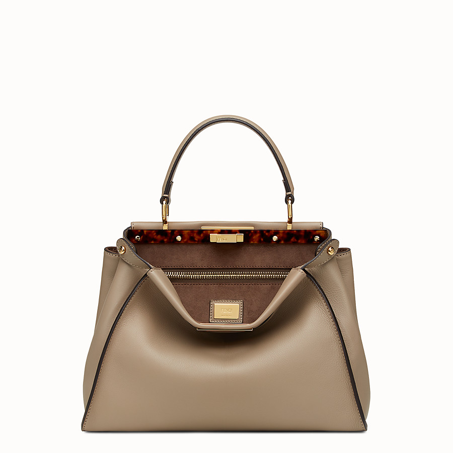 fendi peekaboo - The peekaboo has quickly become a classic bag for the Fendi house. The regular size is perfect for work or running errands, the mini is equally functional and more spacious than you would suspect. It comes with a top handle and cross-body strap for versatility. Retail $5,100