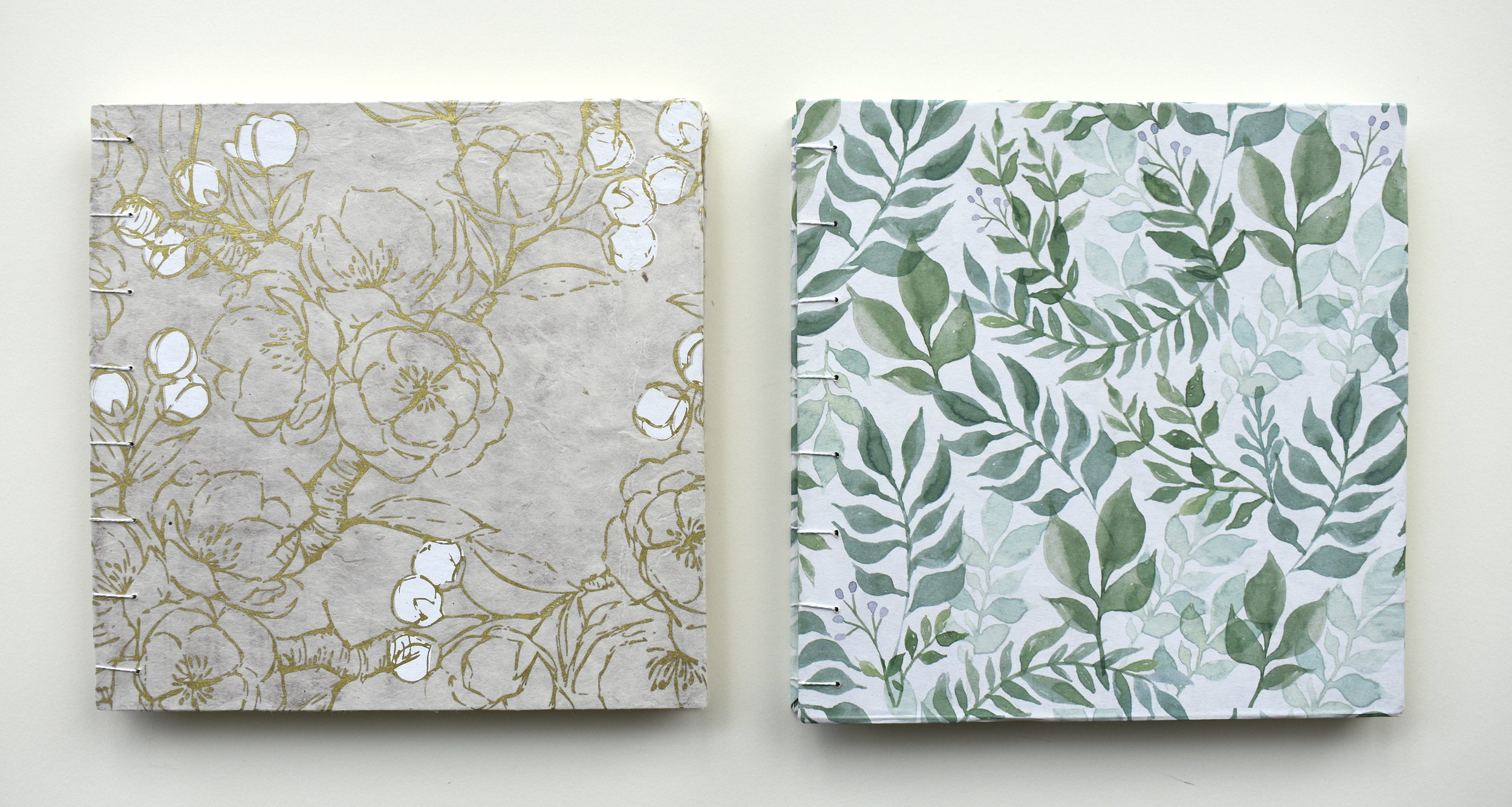 Wedding guest books side by side.JPG