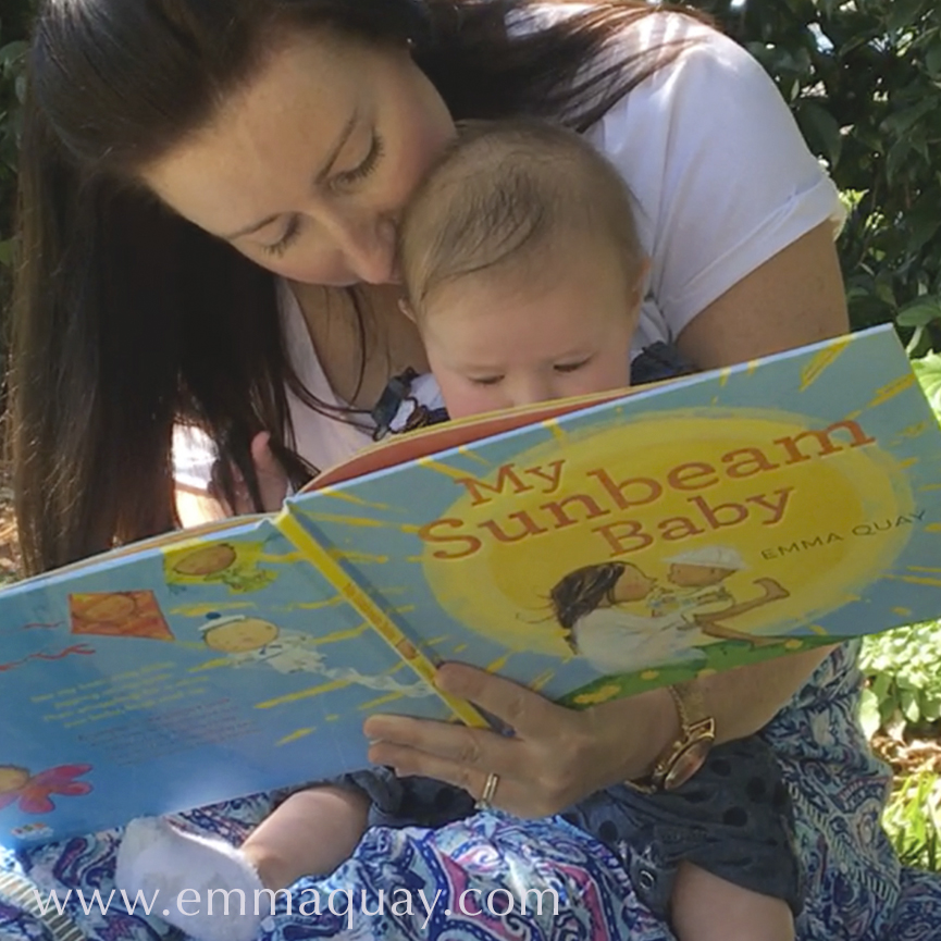 Five-month-old Ava reading MY SUNBEAM BABY, a picture book by Emma Quay (ABC Books) — www.emmaquay.com