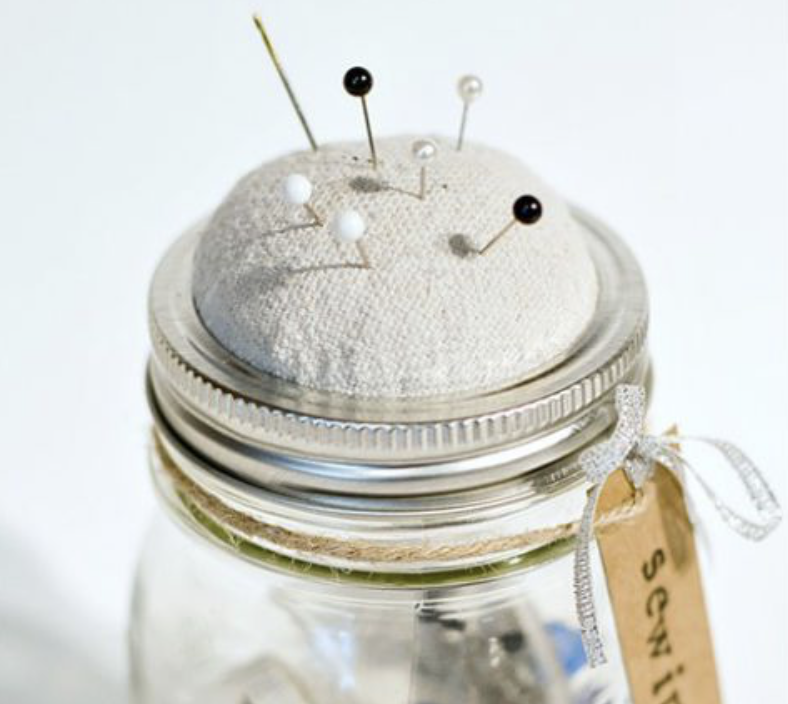 If you're the sewing type, mason jars also come in handy for keeping your tools in one place (and can we say