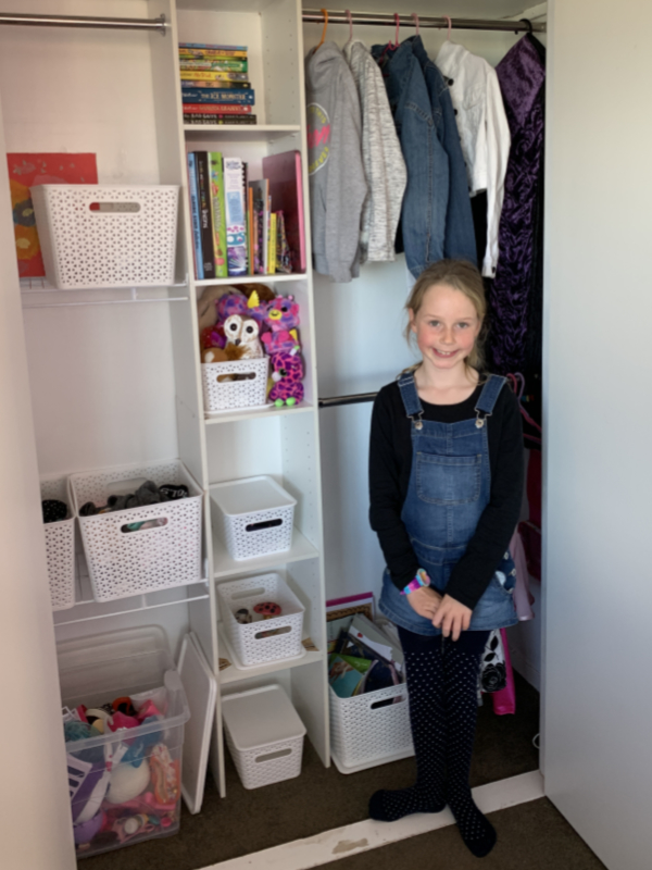 - Happy customer Molly in front of her freshly organised wardrobe.