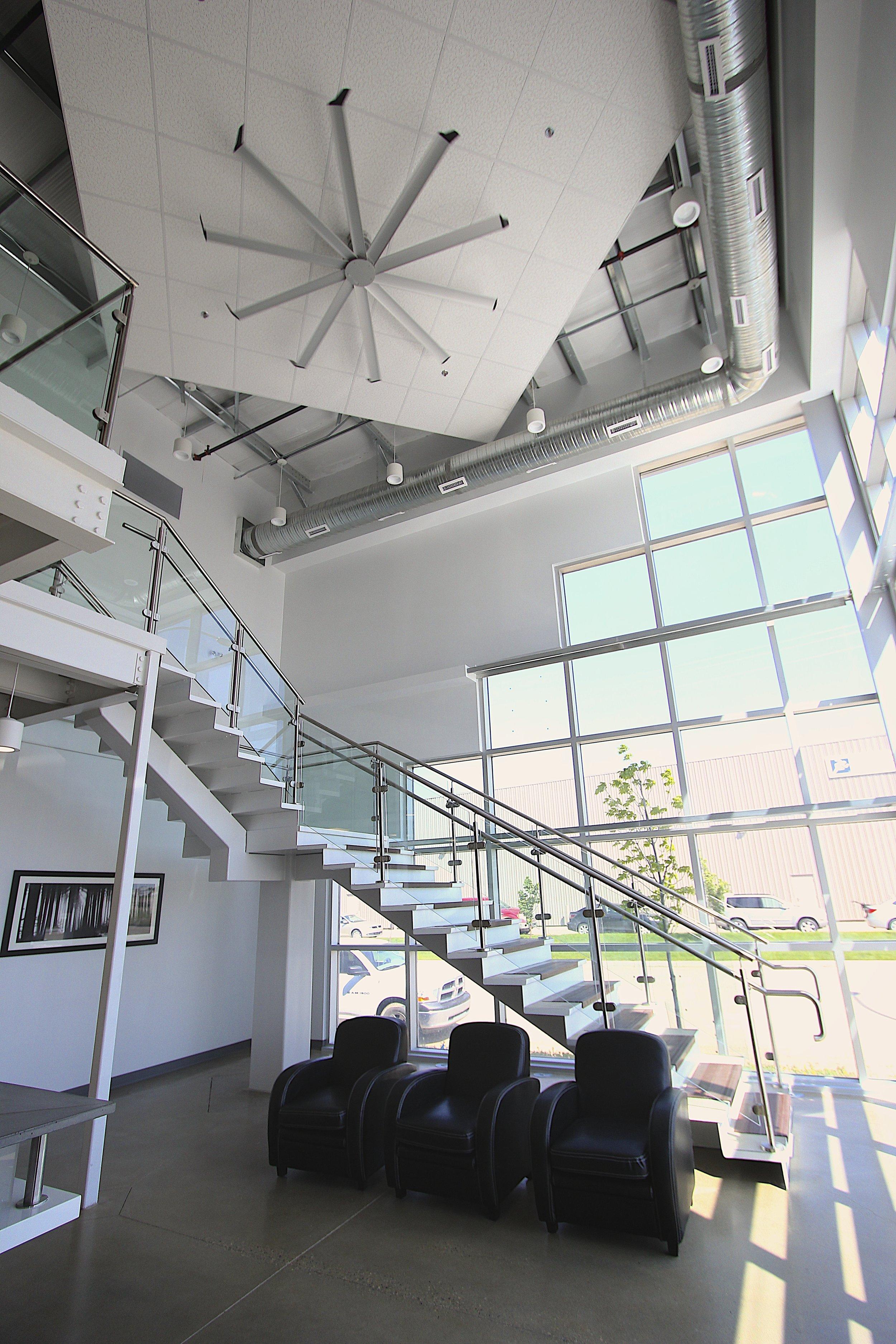 Metric Design, Saskatoon, Interior Design, Renovations, Bulkhead, Exposed Ductwork, Commercial Staircase, Natrual Light.jpg