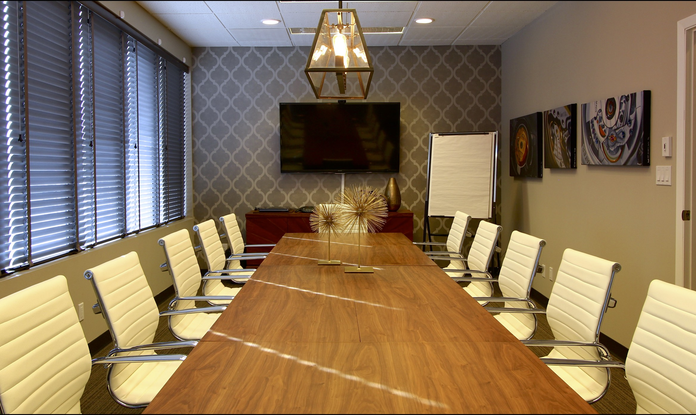 Metric Design Centre, Interior Design, Saskatoon, Commerical Design, Boardroom Table, White Leather Office Chairs, Spike Sculpture, Decor, Decorating, TV, Wallpaper Feature Wall, Art.jpg